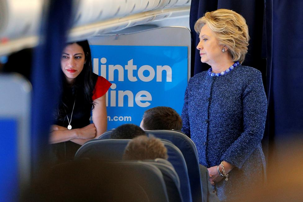Huma Abedin and Hillary Clinton, shortly after hearing that the FBI had discovered new Clinton emails on Anthony Weiner's laptop.